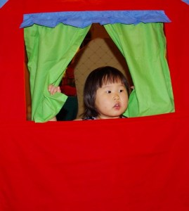 Penelope in Charlie's puppet show arena.