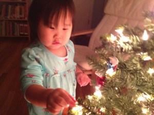 Penelope in PJ's checking out the tree.