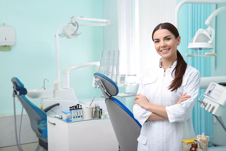 female standing in dental operatory