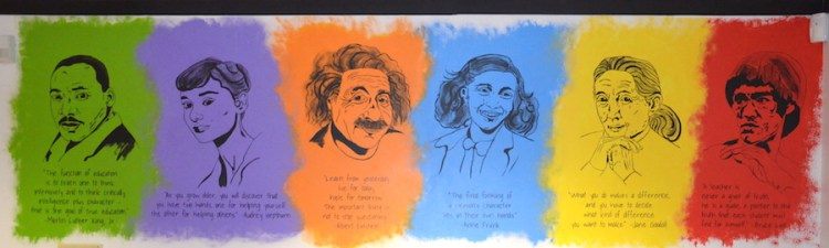 mural of portraits and inspiring quotes
