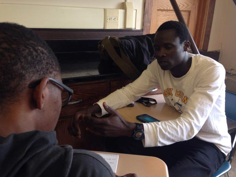 Senior Edwin Rutto as he talks to a reporter about how he will raise his money.