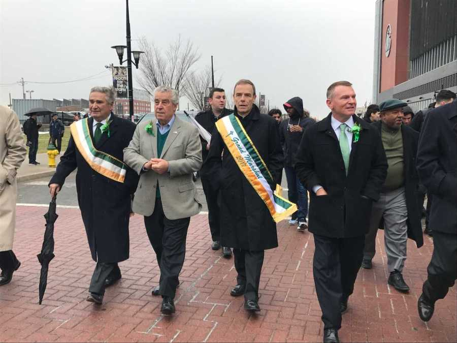Fr. Edwin Leahy O.S.B. walks near the Prudential Center for the St. Patricks Day parade.