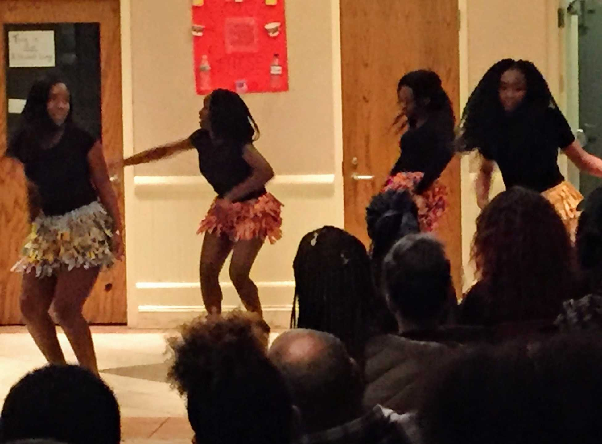 Students from St. Vincent Academy performing an African style dance.