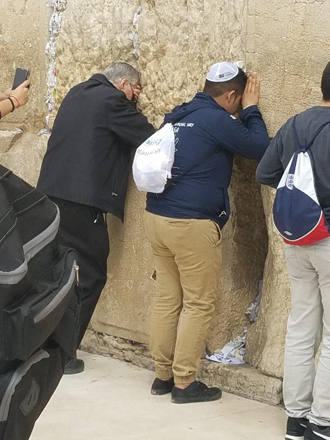 Jacob prays, alongside many others, at the Western Wall.