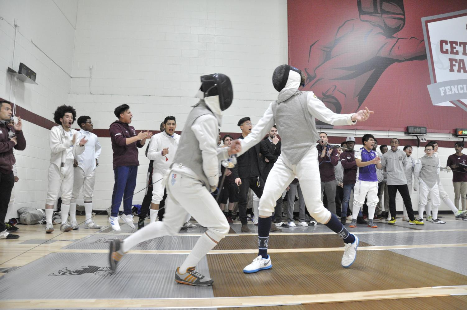 Alex Cruz UDI broke a tie and led the fencing team to victory.