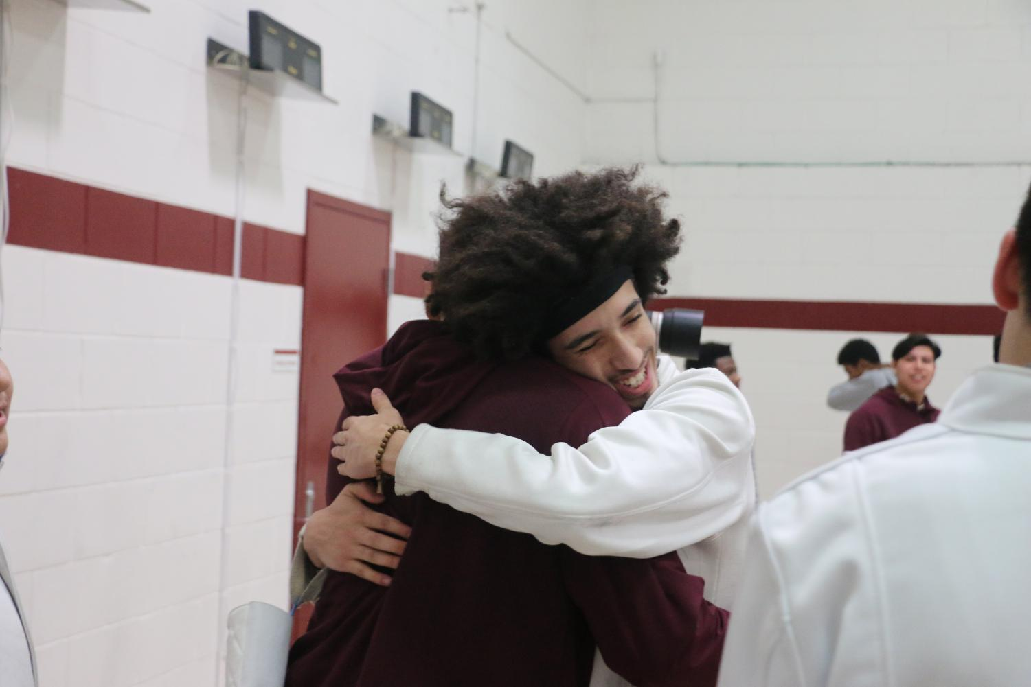 Fencing captains Marc Urquilla '19 and Francisco Perez '19 celebrate a night to remember, their last night fencing at home.