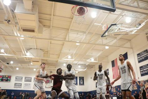 Varsity Basketball Team Defeats Academy New Church