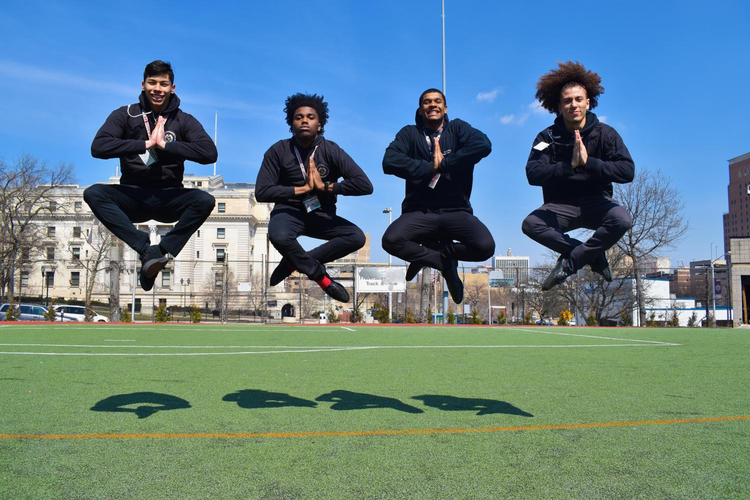 To illustrate the cover photo idea to the ED students, SBP's UD students first demonstrated their leaping technique, working in a momentary lotus position for good measure. From left, Michael Melendez,  Francis Jean-Paul, Jalen Cabrera, and Isaiah Sanchez