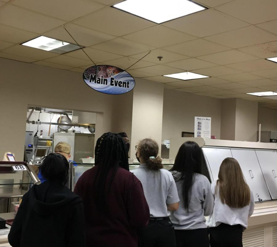 Girls Division students line up to get their lunch at the cafeteria.