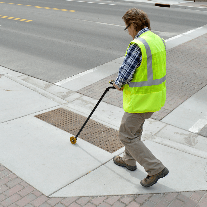 the digital measuring wheel measures curb ramp dimensions while standing