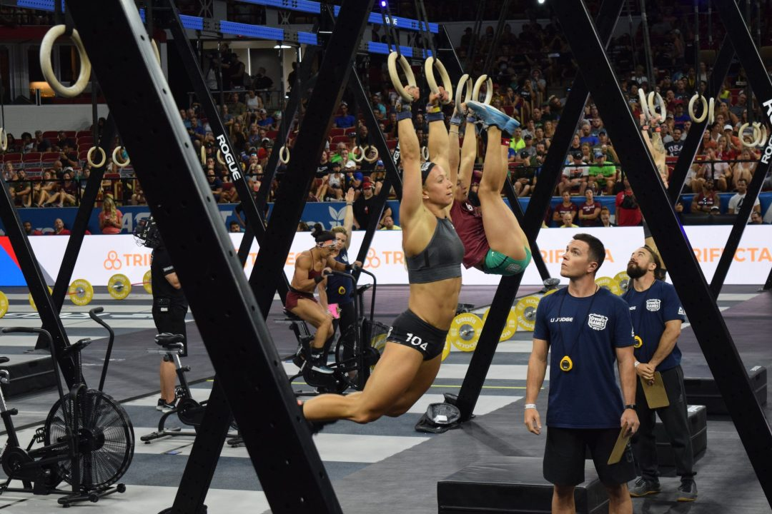 Amanda Barnhart completes toes-to-rings in the Coliseum at the 2019 CrossFit Games.