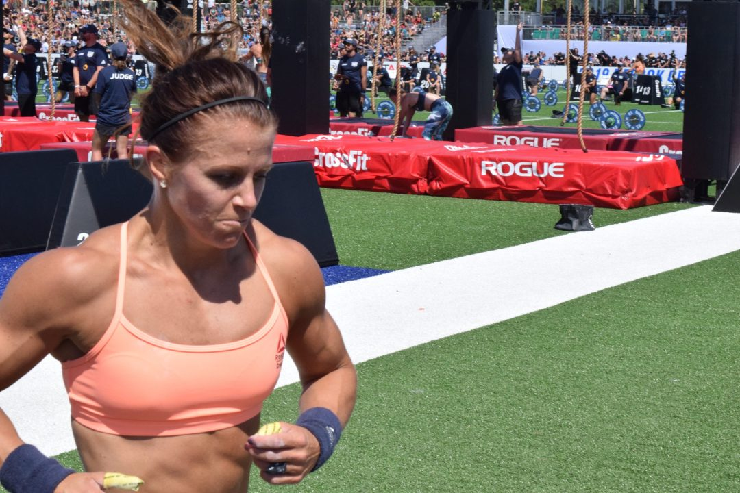 Kriston Holte takes a lap between rounds of legless rope climbs at the 2019 CrossFit Games
