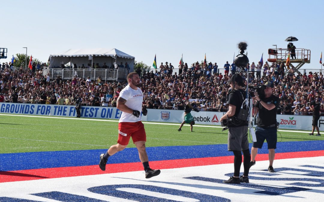 Mat Fraser crosses the finish line of an event at the 2019 CrossFit Games.