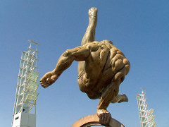 Muscled Male Statue Doing Gymnastics