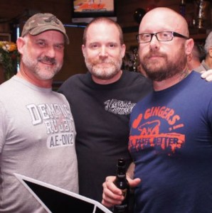 Men at bar friends bulky scruffy