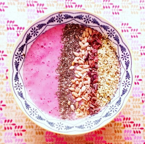 Raspberry Smoothie Bowl with chia seeds, sunflower seeds, cacao nibs and hemp hearts