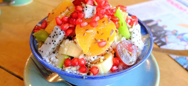 mixed fruit smoothie bowl topped with seeds and superfoods