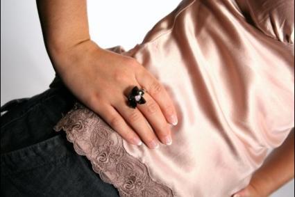 Jewellery model wearing black ring