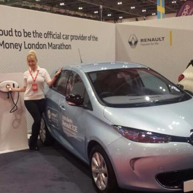 Exhibition staff demonstrating electric car on Renault stand