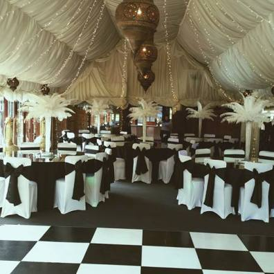 Room Decor black and white with white feather table centres and fairy lights