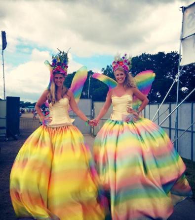 Stilt Walkers dressed in rainbow fairy costumes