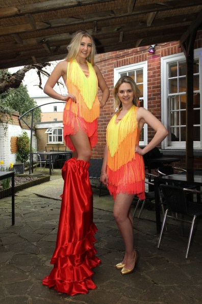 Stilt Walkers in red and orange Carnival theme Costumes for Brazilian Olympics
