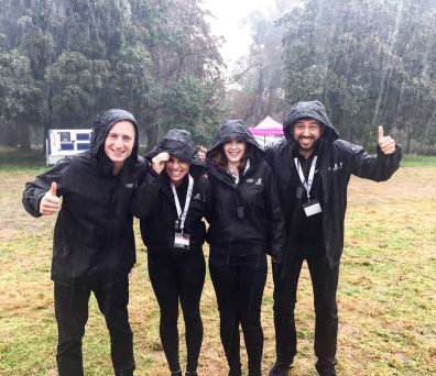 Promotional staff still looking happy in the rain