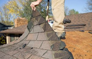 Oakland Roofing Contractor Evaluating Residential Roof for Repair