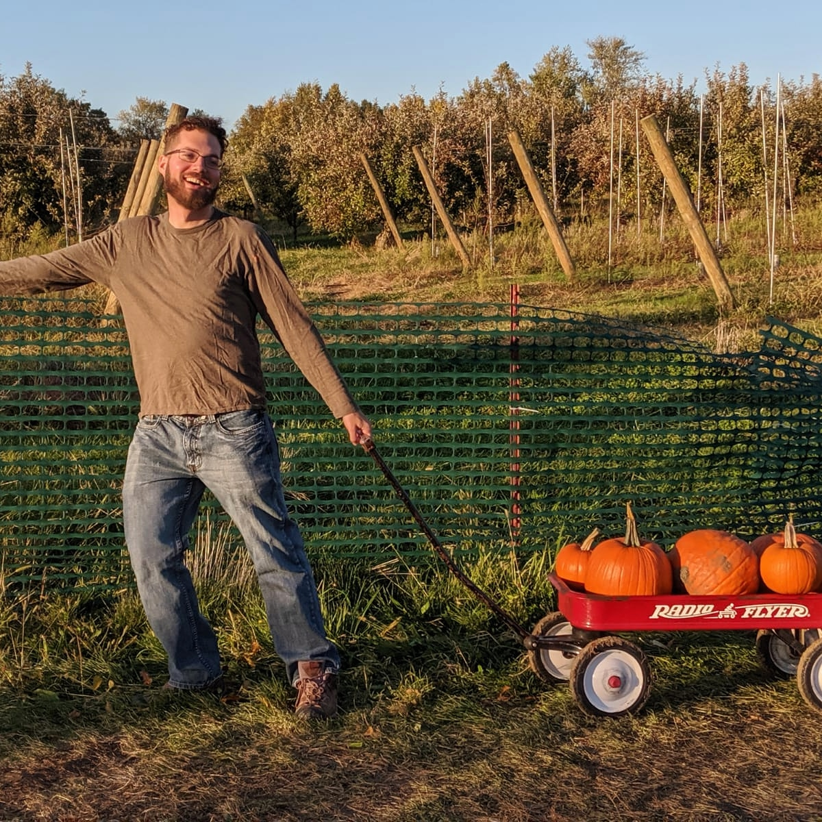 Me hauling a wagon full of pumpkins