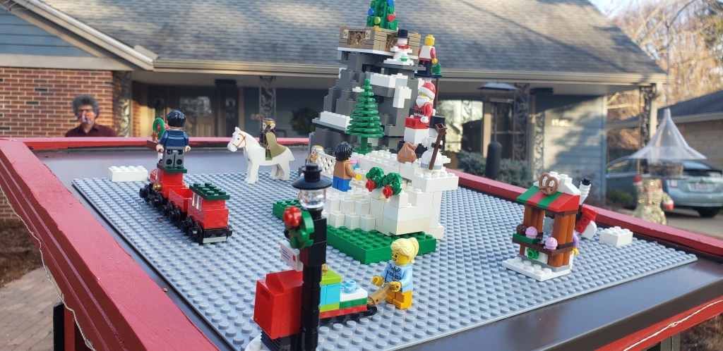 The lego scene is includes, some lord of the rings elves, a mountain with a snowboarder, Santa, a snowman, and a snowblower dude.