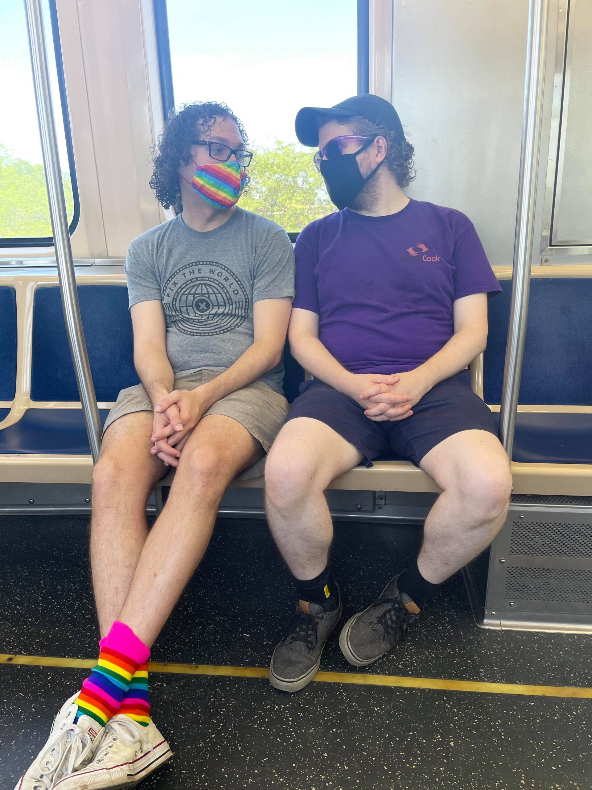 My bf and I looking at each other on the train. We're wearing masks