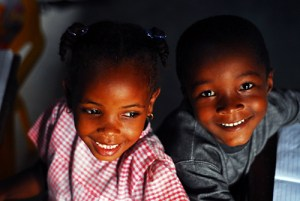 Sao Tome, Generosa, portrait of smiling black boy and girl at school
