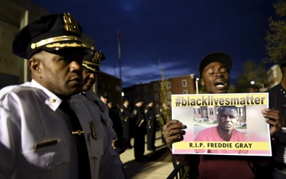 A demonstrator holds a sign in front of the Baltimore Police Department Western District station during a protest against the death in police custody of Freddie Gray in Baltimore A demonstrator holds a sign in front of the Baltimore Police Department Western District station during a protest against the death in police custody of Freddie Gray inBaltimore April 23, 2015. The U.S. Southern Christian Leadership Conference will independently investigate the death of a black Baltimore man in police custody, with the local head of the civil rights group saying it lacked confidence in a police probe into the death. REUTERS/Sait Serkan Gurbuz