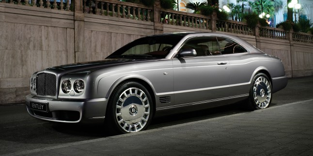The silver Bentley Brooklands parked outside a luxury beach resort   Bentley Motors