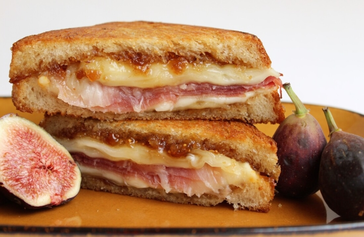 A cut sandwich and figs on a plate, one of the offerings at Lucia's Craft Sandwich, a new East Bay restaurant in October 2020.