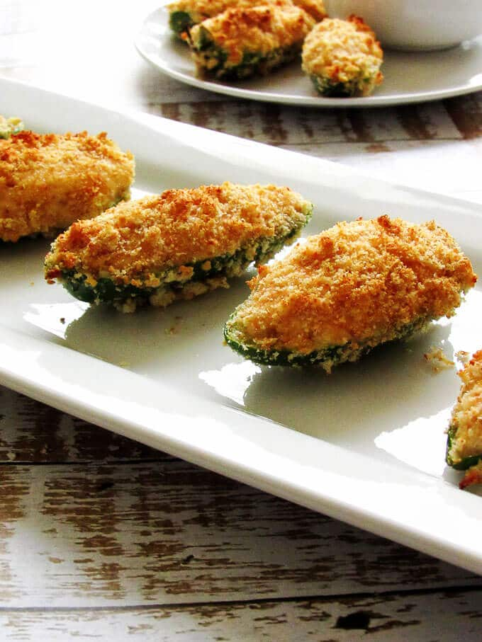 Healthier Jalapeno Poppers are filled with soft cream cheese and smoky paprika, cradled in a spicy jalapeno, and tucked beneath a crunchy breadcrumb topping.