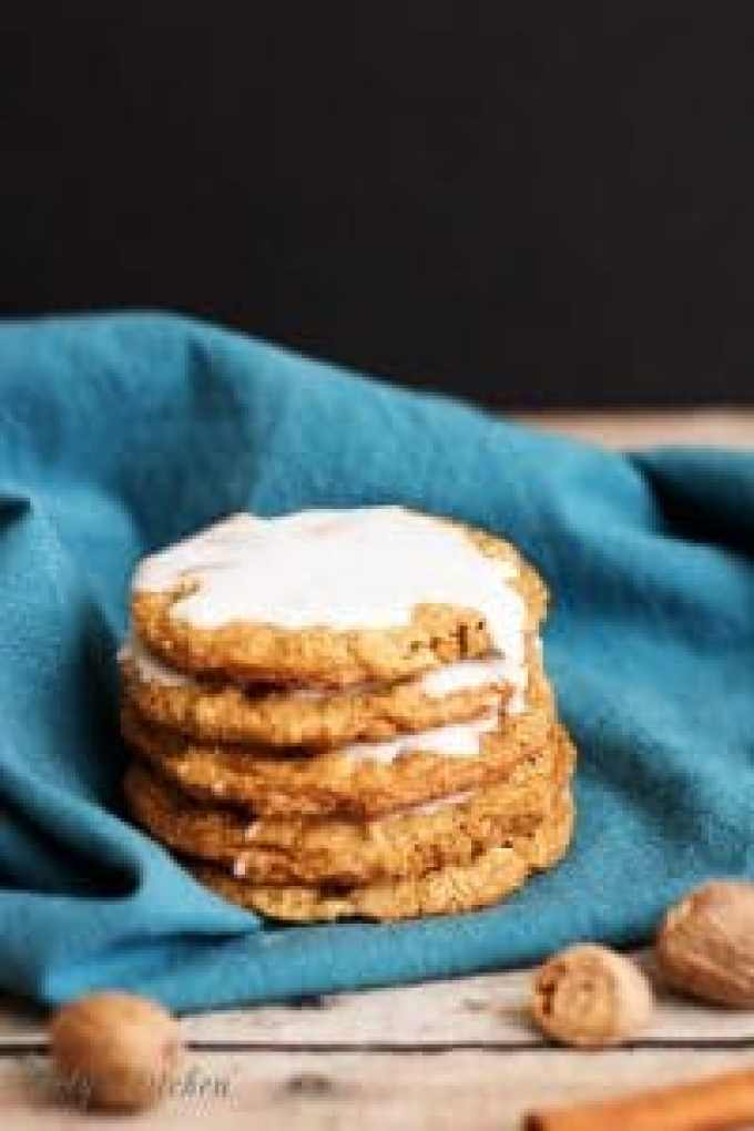 These spiced and iced oatmeal cookies are soft and chewy, loaded with cinnamon, brown sugar, ginger, and nutmeg, and topped with sweet icing.
