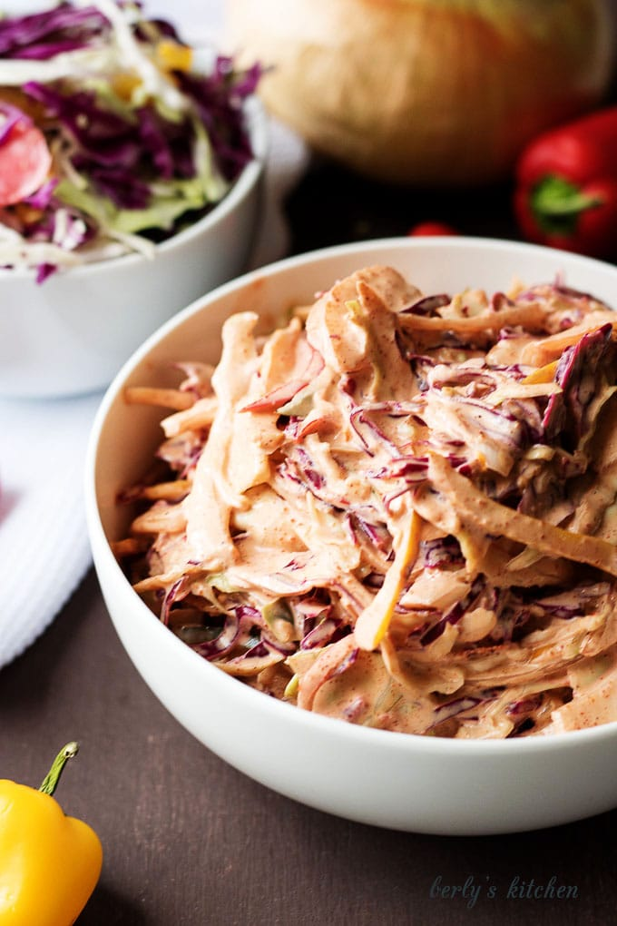A unique spicy coleslaw recipe made with four ingredients and loaded with flavor. It's simple to prepare and is used to top your favorite sandwich or taco.