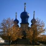 yellow trees in front of church with blue domes