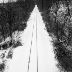 railroad tracks in the snow.
