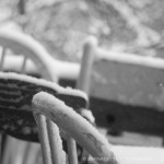wooden chairs with snow