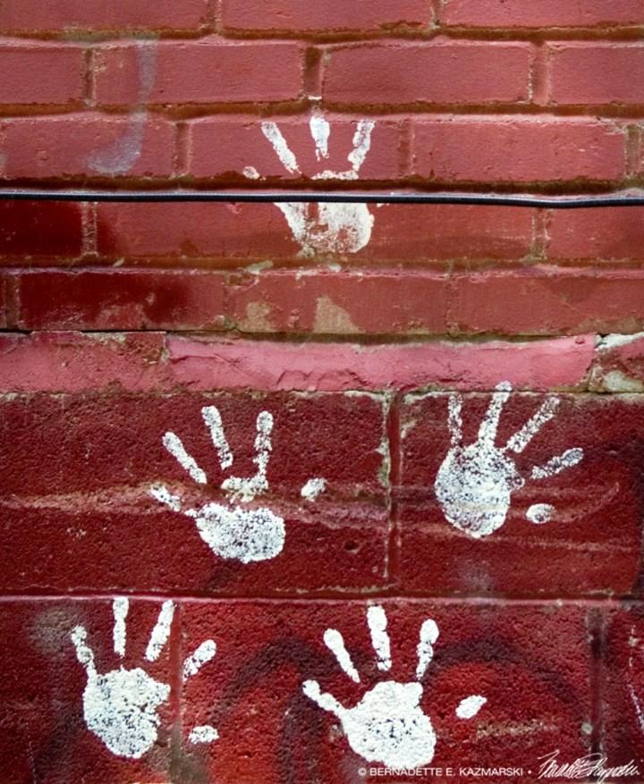 Handprints on Red