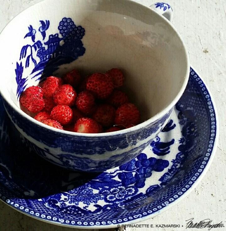 Vintage berries in a vintage cup.