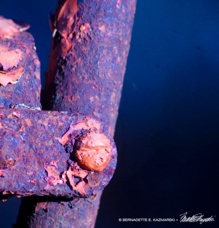 orange paint and orange rust on metal