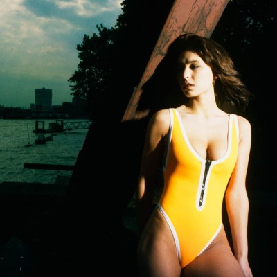 Woman in yellow neoprene swimsuit, eighties fashion
