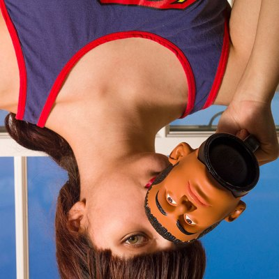 Upside down photo of woman drinking from mug
