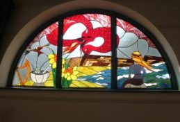 Welsh Legend themed stained glass window at Myddfai Hall designed by Berni, made by the community