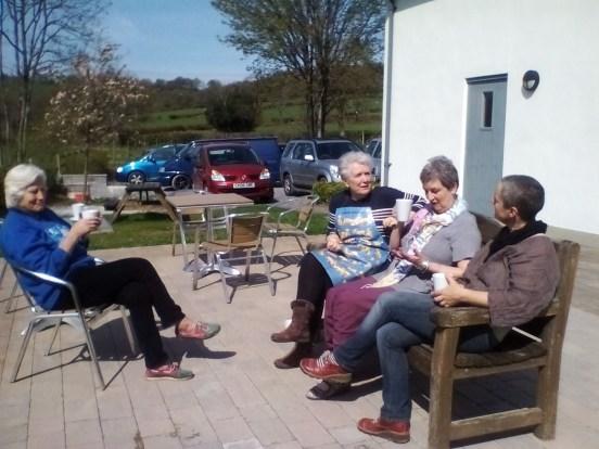 students enjoying a break in the sunshine