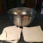 Large mixing bowl, colander that fits inside the bowl, flour sack towels