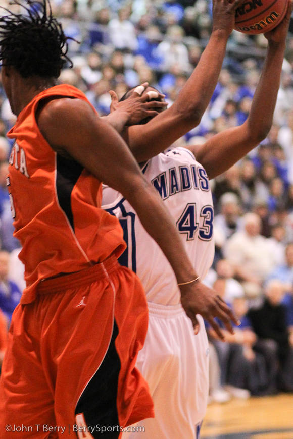This wasn't called a foul....and Logan made the shot!